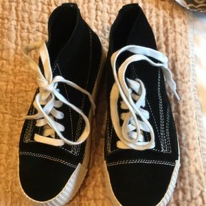 Black and white platform high top sneakers